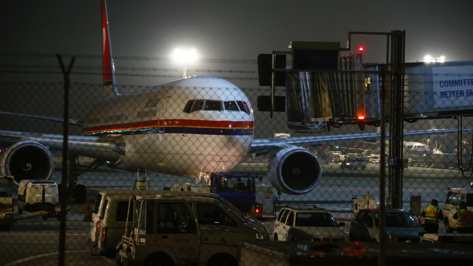 A Meridiana Airlines plane believed to be flying a group of about 50 rejected asylum seekers leaves from Frankfurt Rhein-Main Airport in Germany, Dec. 14, 2016.