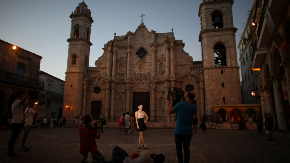 Yazuli Lloret, 15, poses for a photographer at the Cathedral Square in Havana, Cuba, December 27, 2016.