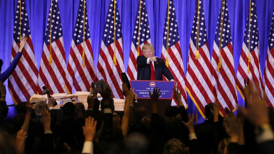 U.S. President-elect Donald Trump calls on reporters during a news conference in the lobby of Trump Tower in Manhattan, New York City, U.S., January 11, 2017.