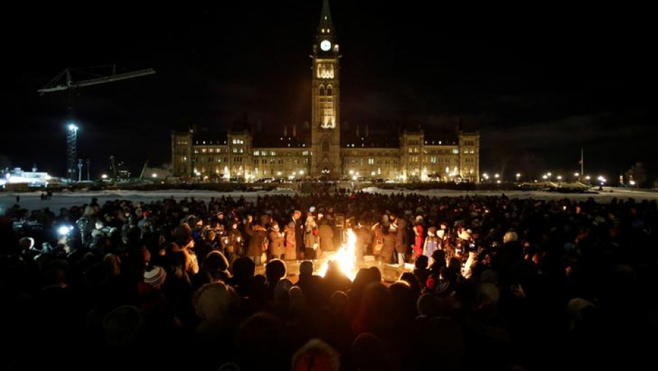 People gather around the Centennial Flame on Parliament Hill during a vigil following a deadly shooting at a Quebec City mosque, in Ottawa, Ontario, Canada, January 30, 2017.
