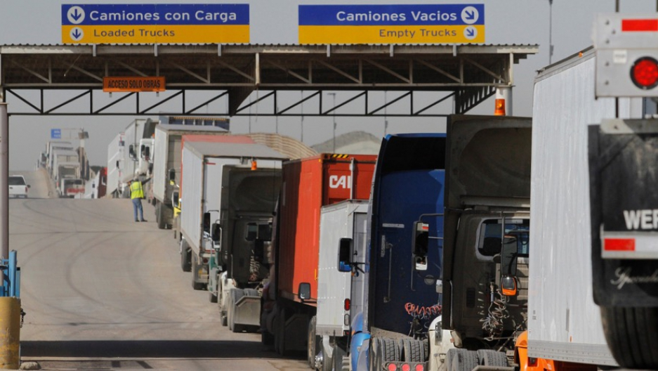 Trucks wait in a long line for border customs control to cross into the US at the Otay border crossing in Tijuana, Mexico.