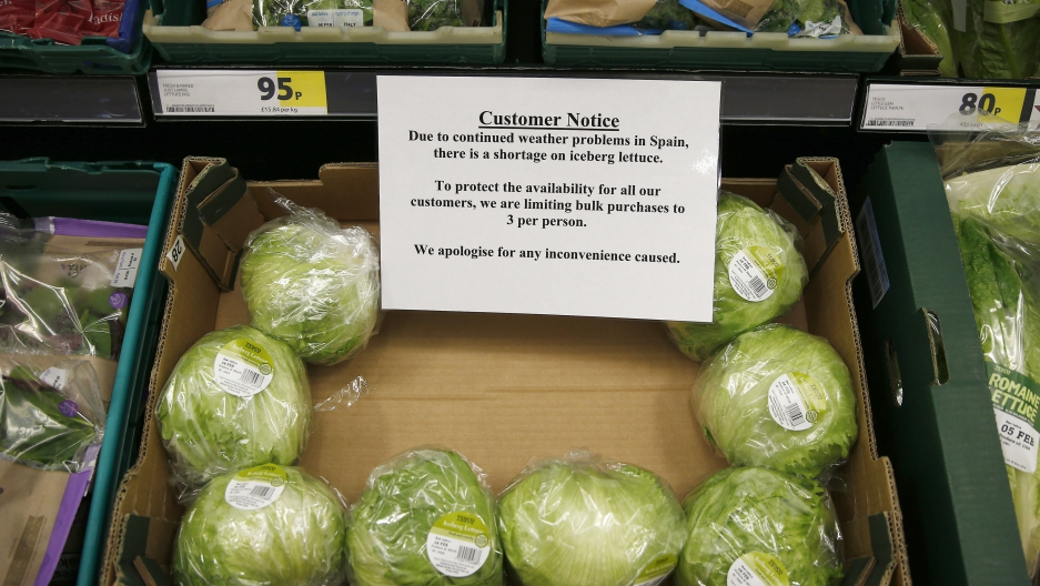 Iceberg lettuces are seen next to a sign requesting that customers limit their purchase in a supermarket, in London, Britain February 3, 2017.
