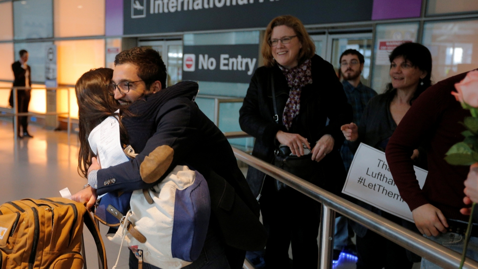Behnam Partopour, a Worcester Polytechnic Institute (WPI) student from Iran, is greeted by his sister Bahar (L) at Logan Airport after he cleared U.S. customs and immigration on an F1 student visa in Boston, Massachusetts, U.S. February 3, 2017. Partopour