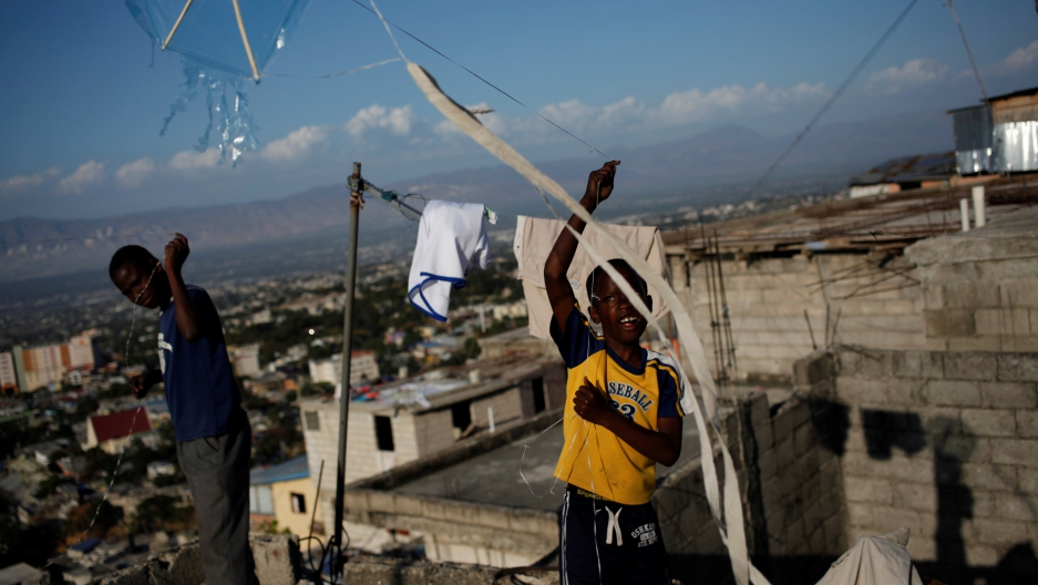 Children fly kites in a neighborhood of Port-au-Prince, Haiti, February 8, 2017.