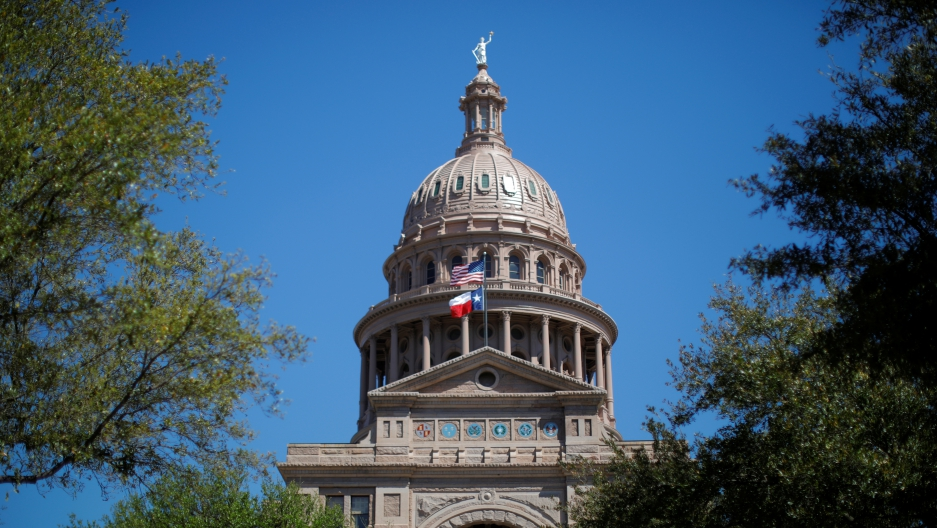 The US flag and the Texas state flag fly over the Texas State Capitol in Austin, Texas, U.S., March 14, 2017.