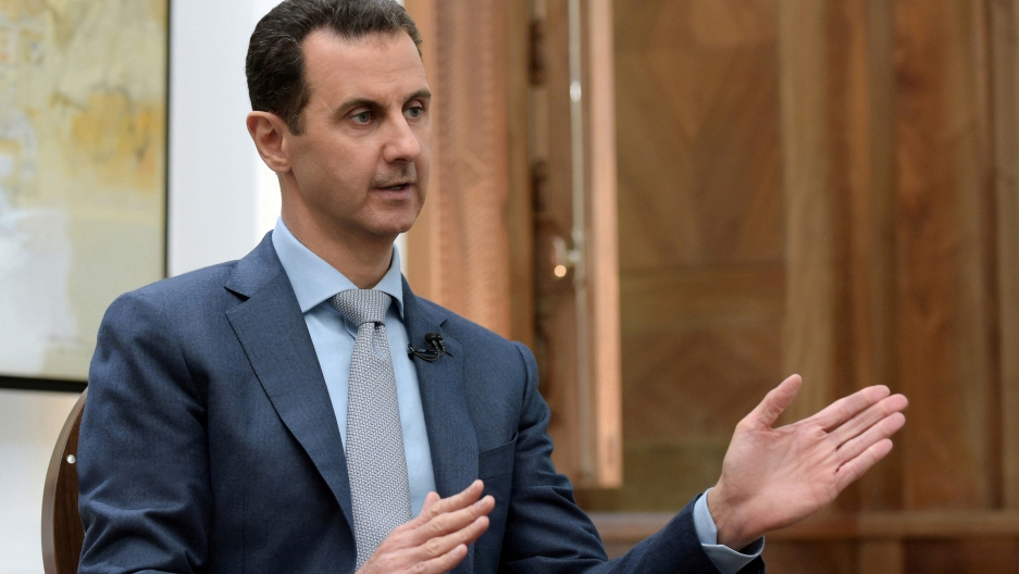 Syria's President Bashar al-Assad speaks during an interview with Yahoo News in this handout picture provided by SANA on February 10, 2017, Syria.