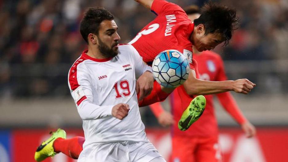 Soccer - South Korea v Syria - World Cup 2018 Qualifiers - Seoul World Cup Stadium, Seoul, South Korea -  South Korea's Kim Jin-su and Syria's Mardkian Mardek in action
