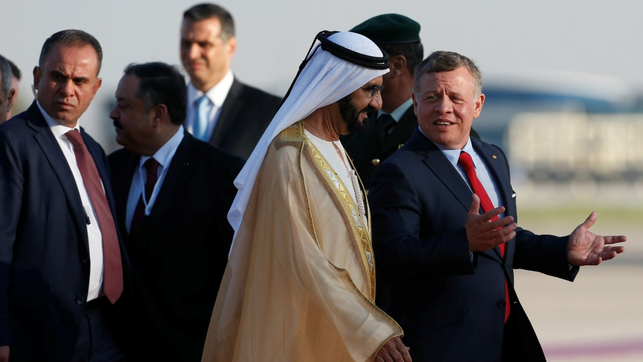 Jordan's King Abdullah II welcomes Prime Minister and Vice-President of the United Arab Emirates and ruler of Dubai Sheikh Mohammed bin Rashid al-Maktoum during a reception ceremony at the Queen Alia International Airport in Amman, Jordan, March 28, 2017.