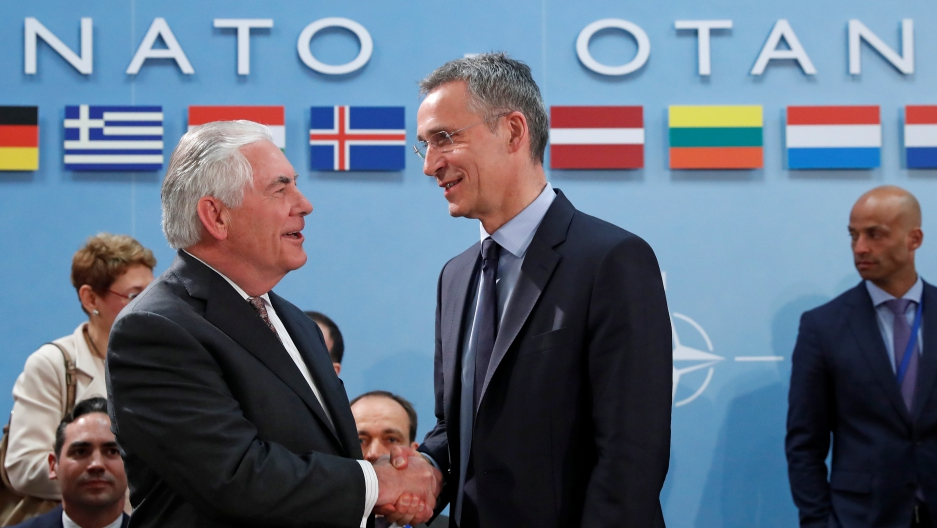 U.S. Secretary of State Rex Tillerson (L) shakes hands with NATO Secretary General Jens Stoltenberg during a NATO foreign ministers meeting at the Alliance's headquarters in Brussels.