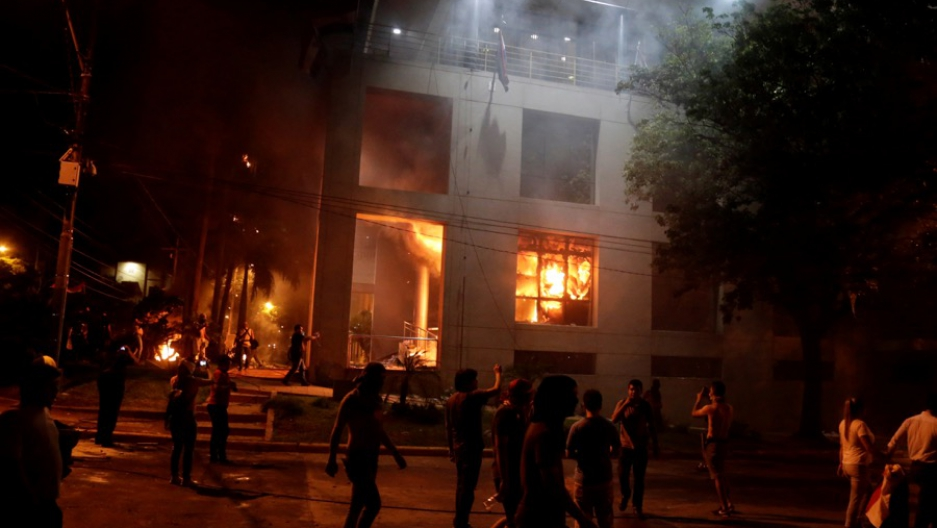 Protesters set fire to the congress building during a demonstration against a possible change in the law to allow for presidential re-election in Asunción, Paraguay on March 31.