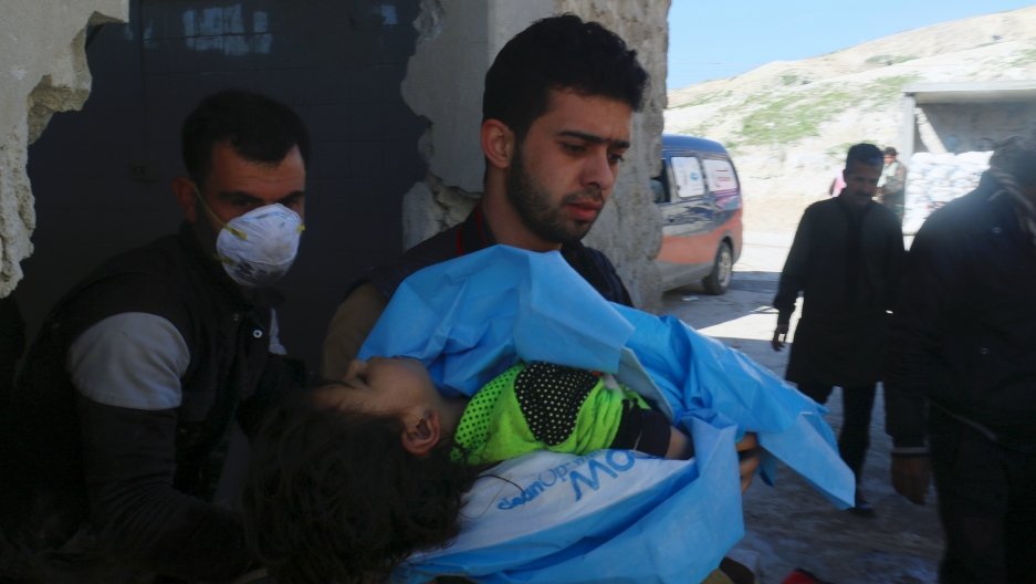 A man carries the body of a dead child, after what rescue workers described as a suspected gas attack in the town of Khan Sheikhoun in rebel-held Idlib, Syria, April 4, 2017.