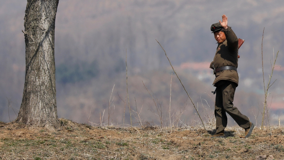 When many South Koreans look at North Korea, they just don't see much to fear. Shown here, a North Korean soldier waves to tourists on a Chinese boat sailing the Yalu River near the North Korean town of Sinuiju, April 2, 2017.