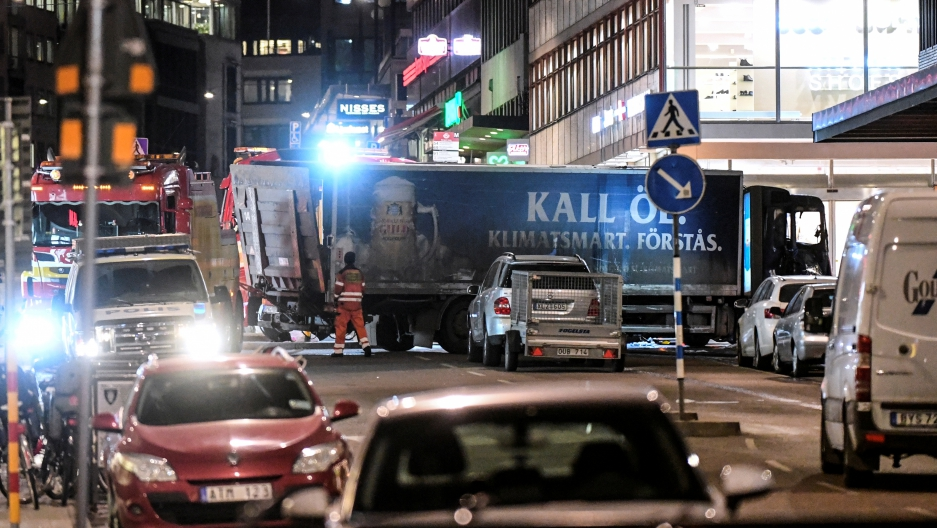 Tow trucks move the beer truck that crashed into the department store Ahlens after plowing down the Drottninggatan Street in central Stockholm, Sweden, April 7, 2017.