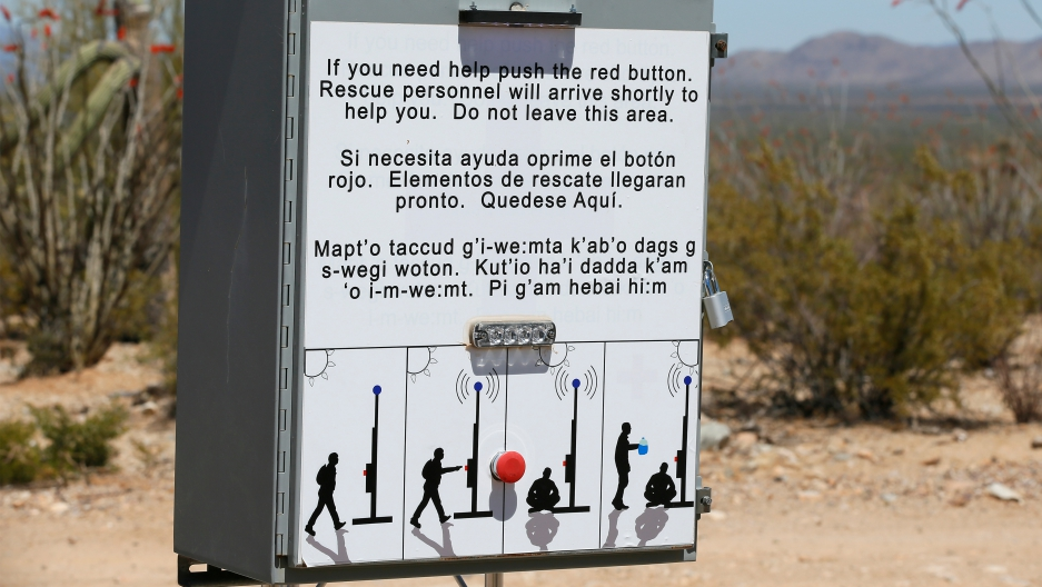 Sign box at border with button to press for help