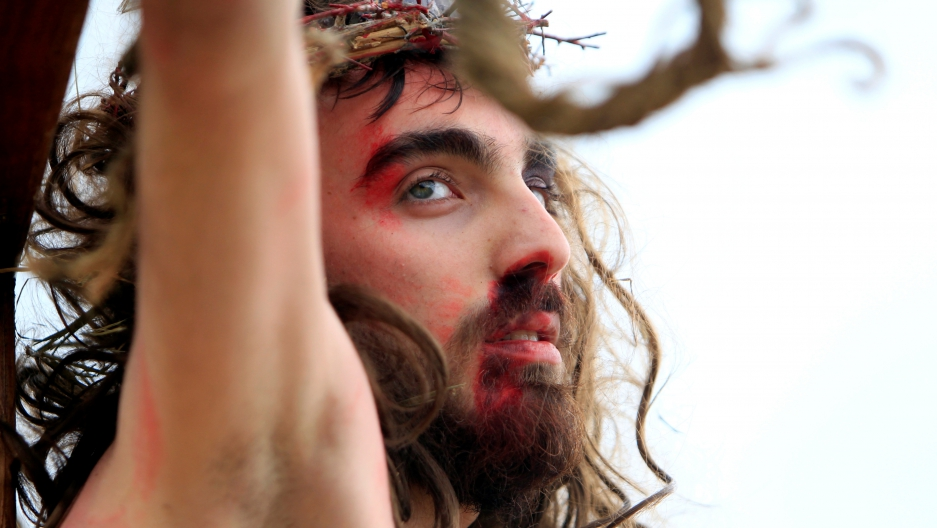 A Christian man, portraying Jesus Christ, is hung on a cross during a re-enactment of the crucifixion of Jesus Christ on Good Friday in al-Qraya village, in southern Lebanon on April 14, 2017. Muslims also revere Jesus as a prophet. In the Quran, the stor