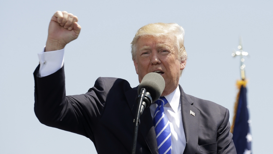 President Trump addressing the graduating class of the Coast Guard Academy in New London, Connecticut