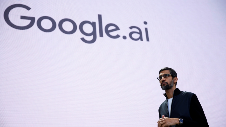 Google CEO Sundar Pichai stands on a stage