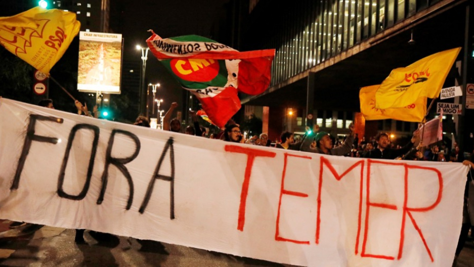 "Demonstrators protest against Brazil's President Michel Temer in Sao Paulo, Brazil, May 17. The banner reads: ""Out Temer."""