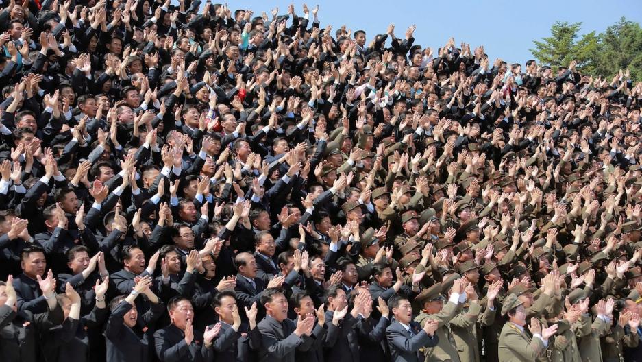 North Korean nuclear scientists cheer leader Kim Jong Un