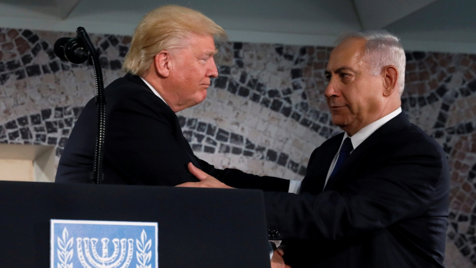 Trump embraces Netanyahu before his remarks at the Israel Museum in Jerusalem
