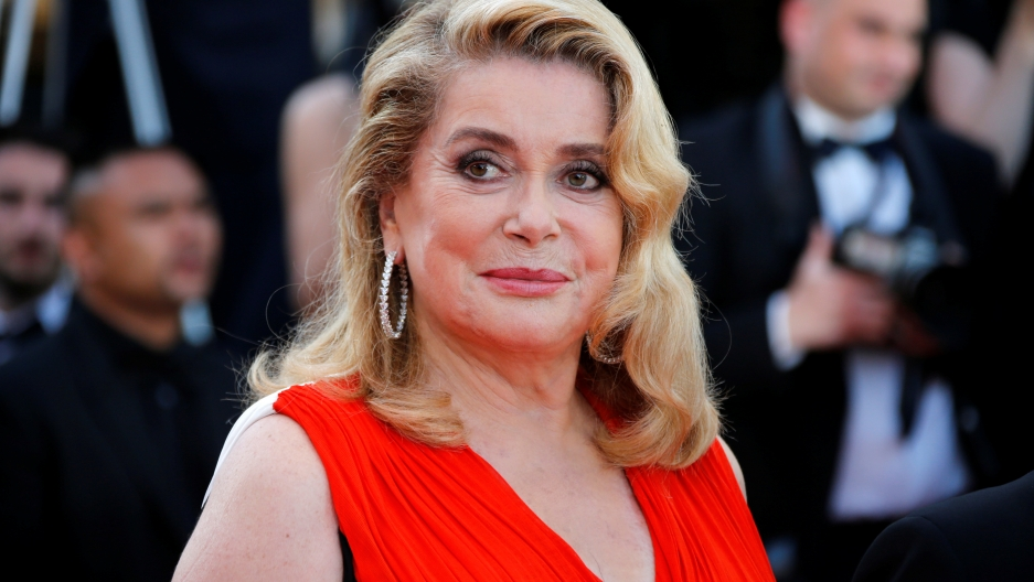 Actress Catherine Deneuve poses at the 70th Cannes Film Festival.