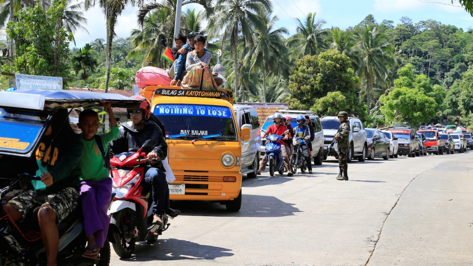 Marawi residents are evacuated from their city in the southern Philippines on May 24, 2017.