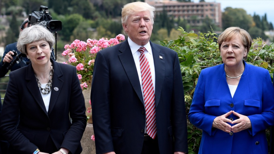 Britain's Prime Minister Theresa May, US President Donald Trump and German Chancellor Angela Merkel