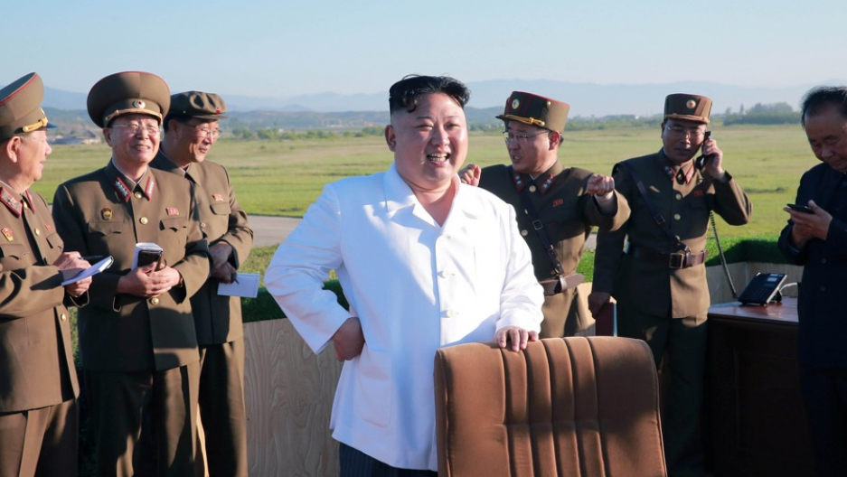 North Korean leader Kim Jong-un watching the test of an anti-aircraft guided weapon system