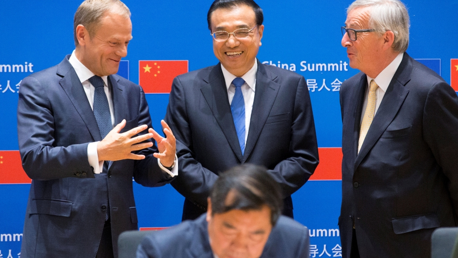 European Council President Donald Tusk, Chinese Premier Li Keqiang and EU Commission President Jean-Claude Juncker attend a signing ceremony during a EU-China Summit in Brussels, Belgium June 2, 2017.