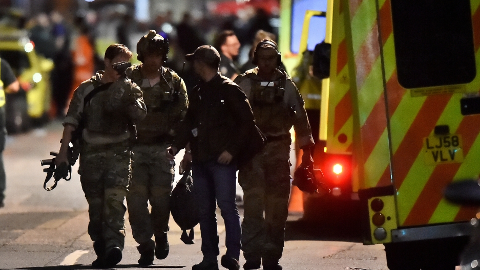 Armed officers attend to an incident near London Bridge in London, Britain, June 4, 2017.