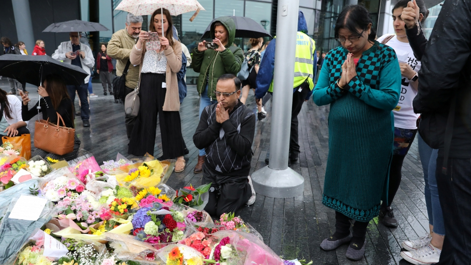 People pray after a vigil to remember the victims of the attack on London Bridge and Borough Market, at Potters Field Park, in central London, Britain, June 5, 2017.