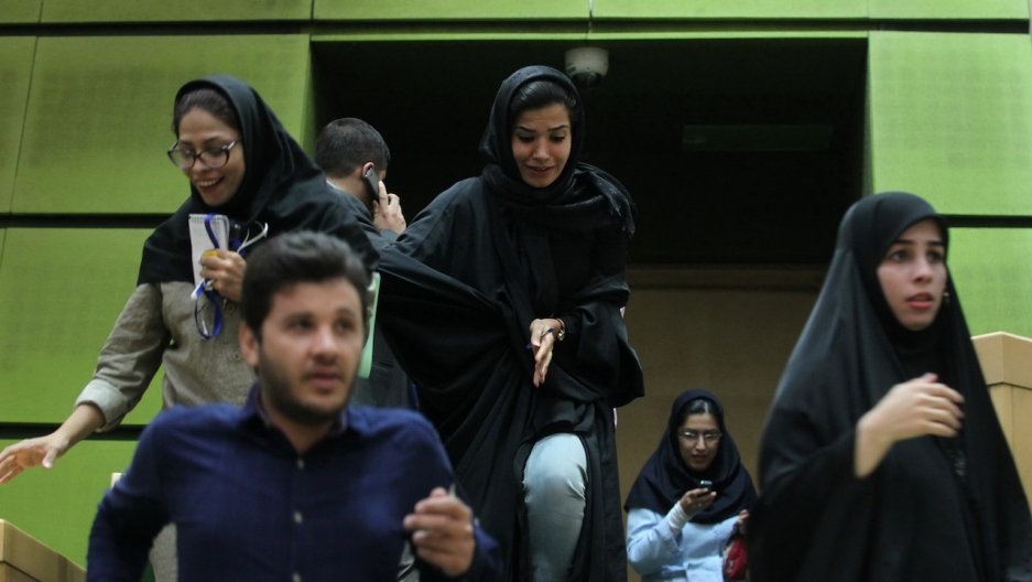 People are seen inside Iran's parliament during an attack in central Tehran