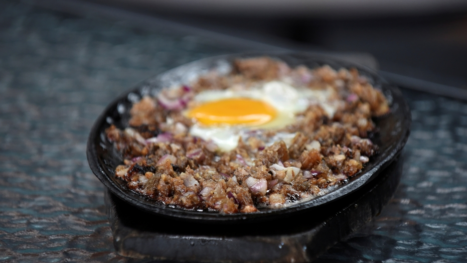 small skillet on stove with ground meat dish cooking