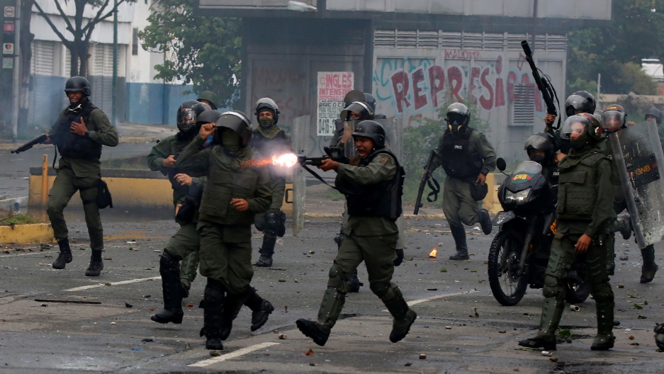 Riot security forces clashing with demonstrators rallying against Venezuela's President Nicolás Maduro's government in Caracas, Venezuela, on July 28.