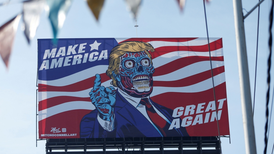 A big billboard shows an illustration depicting President Donald Trump, along Periférico avenue in Mexico City, Mexico, on July 28, 2017.