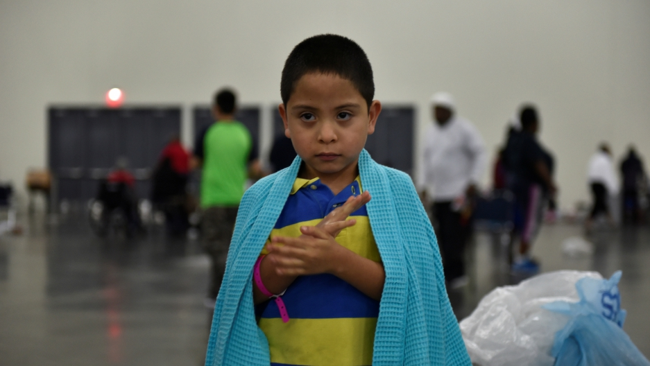 Evacuee Pete Quintana Jr. is wrapped in a blanket at the George R. Brown Convention Center after Hurricane Harvey in Houston, Texas, Aug. 28, 2017.