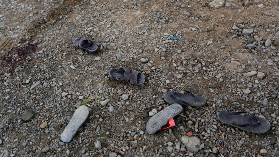 Shoes are seen left in a road near Maungdaw, Myanmar, Aug. 30, 2017.
