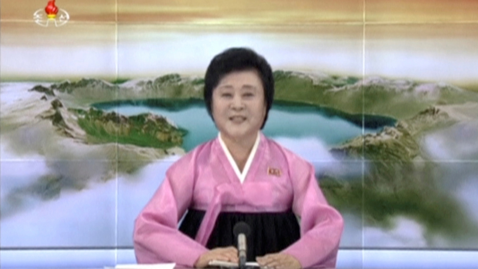 "Ri Chun Hee, the ""Pink Lady,"" making an important announcement on North Korean television"