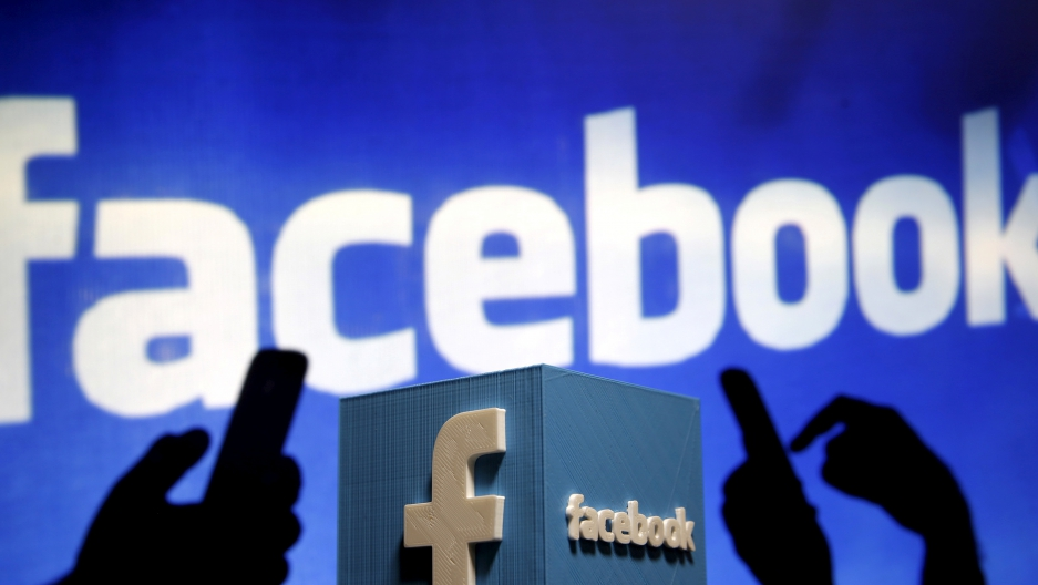 A 3D plastic representation of the Facebook logo is seen in this illustration photo May 13, 2015.