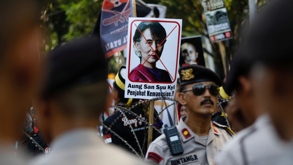 A placard with the picture of Aung San Suu Kyi, accusing her of crimes against humanity, is seen at a rally near the Myanmar embassy in Jakarta.