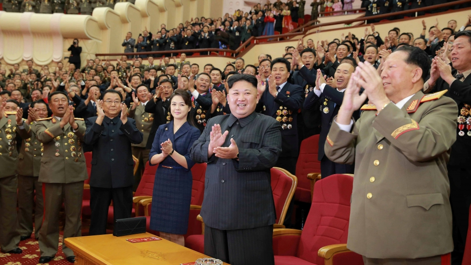 North Korean leader Kim Jong-un claps during a celebration for nuclear scientists and engineers who contributed to a hydrogen bomb test, in this undated photo released by North Korea's Korean Central News Agency (KCNA) in Pyongyang on September 10, 2017.