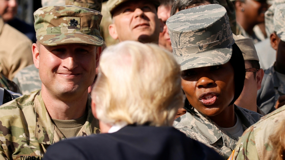 U.S. President Donald Trump greets military personnel while attending the 9/11 observance at the National 9/11 Pentagon Memorial in Arlington, Virginia on September 11, 2017.