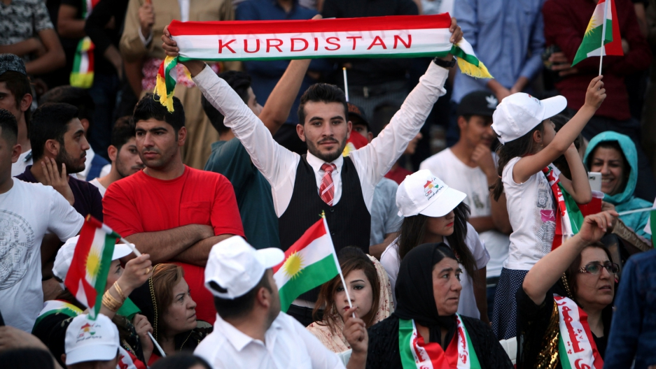 Kurds celebrate to show their support for the upcoming independence referendum in Erbil, in nothern Iraq.