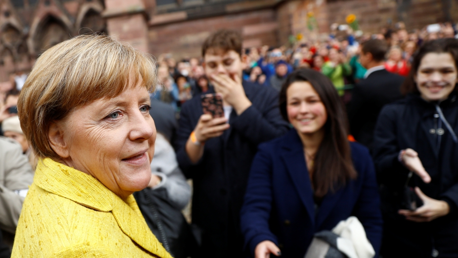 German Chancellor Angela Merkel, the top candidate of the Christian Democratic Union Party (CDU) for the upcoming general elections, greets supporters during a campaign rally.