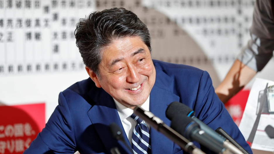 Japan's Prime Minister Shinzo Abe, leader of the Liberal Democratic Party, smiles during a news conference after Japan's lower house election, at the LDP headquarters in Tokyo, Japan, Oct. 22, 2017.