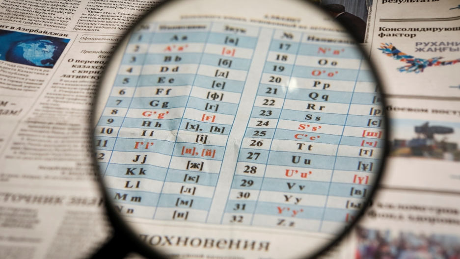 An illustration image shows the new Latin-based Kazakh alphabet published in a newspaper in Almaty, Kazakhstan, on Oct. 27, 2017.