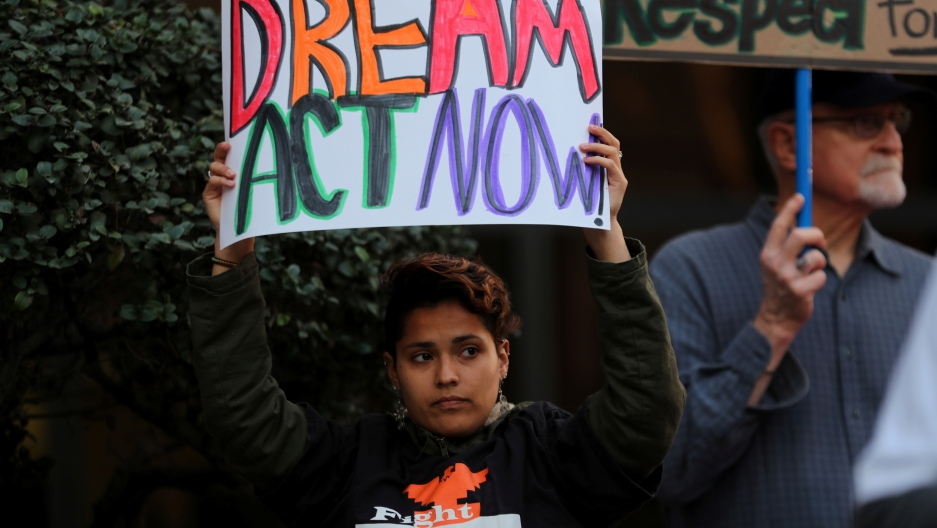 A women demanding action by the federal government on the Deferred Action for Childhood Arrivals (DACA) protests with a group in downtown San Diego.