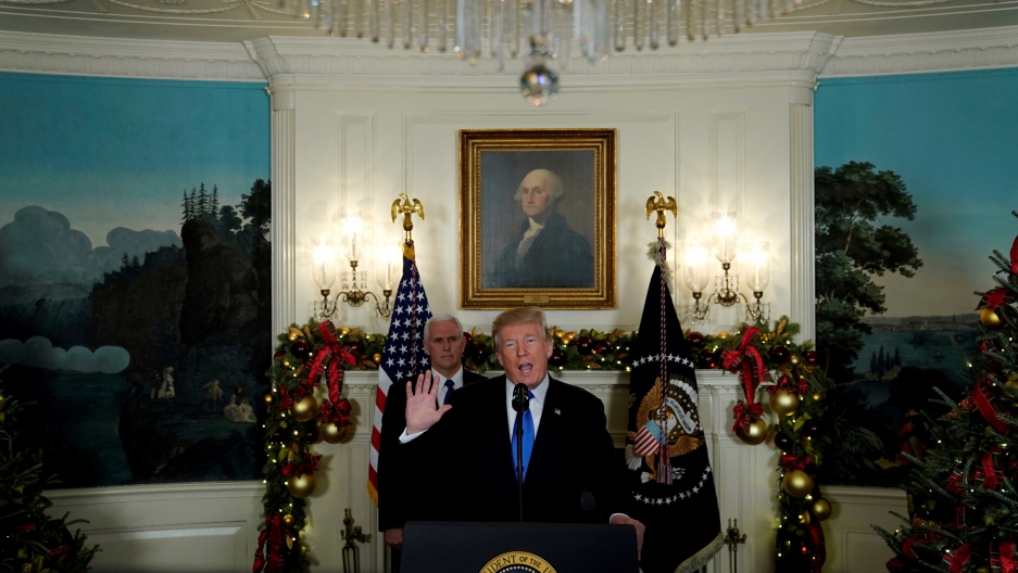 President Donald Trump, flanked by Vice President Mike Pence, delivers remarks recognizing Jerusalem as the capital of Israel at the White House in Washington, DC on December 6, 2017.