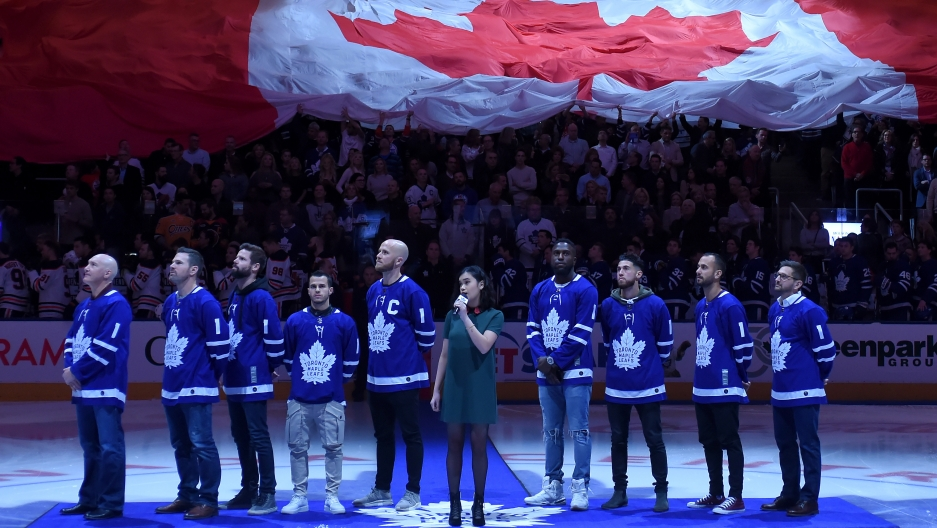 Members of Major League Soccer champs Toronto FC stand for the anthems after being honored in a pre-game ceremony.