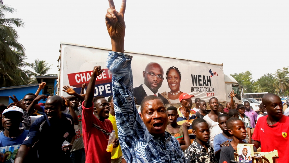 Supporters of George Weah, former soccer player and presidential candidate of Coalition for Democratic Change (CDC), celebrate after the announcement of the presidential election results in Monrovia, Liberia